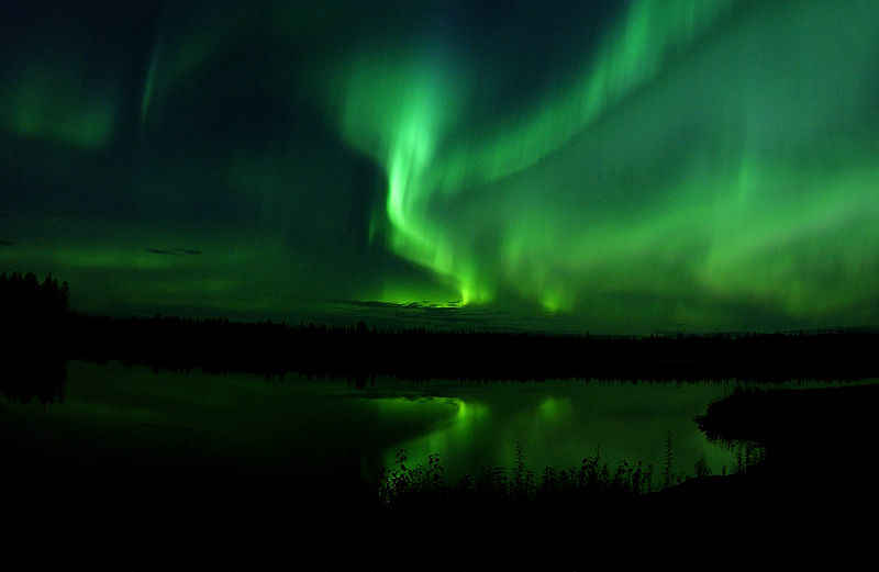 The_Aurora_Borealis_or_Northern_Lights_shine_above_Bear_Lake_in_Alaska_050910-F-MS415-009